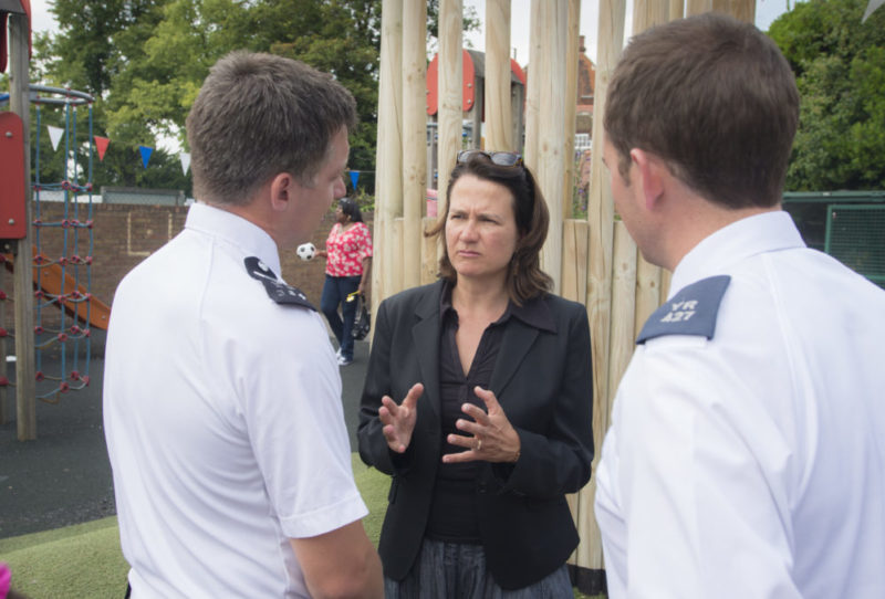 Catherine talking to police officers